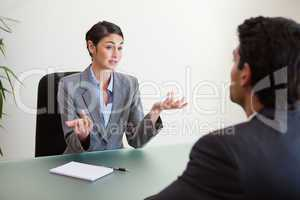 Manager interviewing an employee