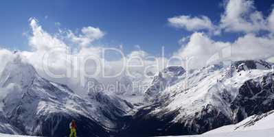 Panorama Caucasus Mountains. Slope with skier.
