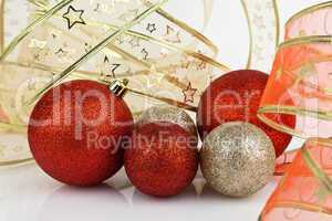 Gold and red Christmas baubles.