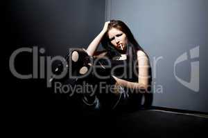 Young anger grunge girl sit in corner and smoke