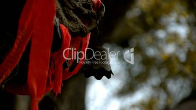 Dragon and metal bell on censer,Red ribbon blowing in wind,Trees,shade.