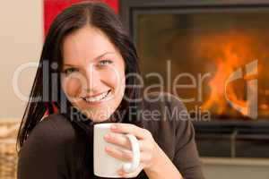 Winter home fireplace woman drink hot coffee