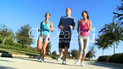 Young Running Partners on Suburban Roads