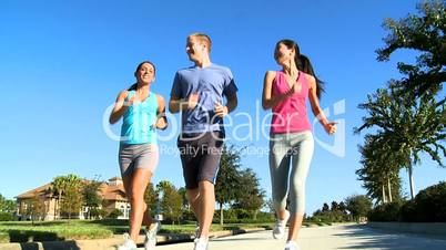 Three Young Friends Jogging Together