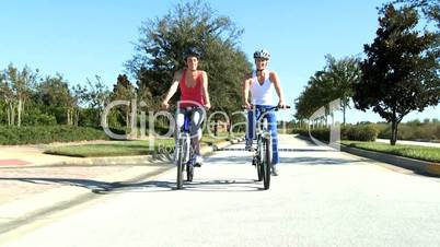 Caucasian Female Friends Cycling on Suburban Roads