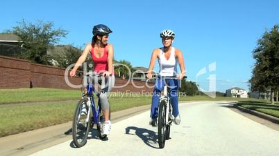 Fit Young Female Friends Cycling Together