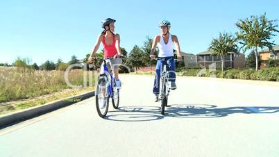 Healthy Female Friends Cycling Together