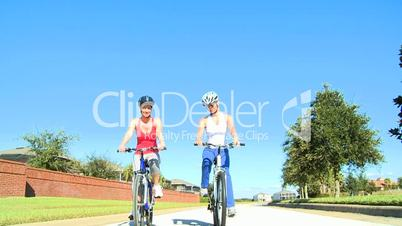 Female Friends Cycling Fun Together