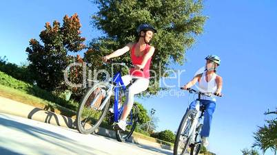 Female Friends Cycling Together