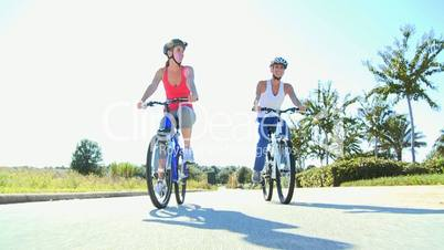 Young Females Keeping Fit and Healthy Cycling