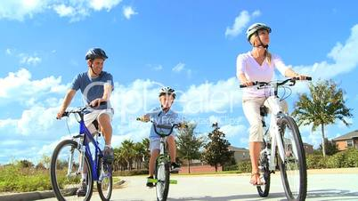 Healthy Caucasian Family Cycling Together