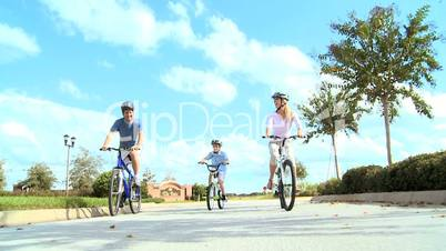 Healthy Caucasian Family Bike Riding Together