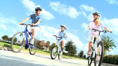 Healthy Young Family Enjoying Cycling Together