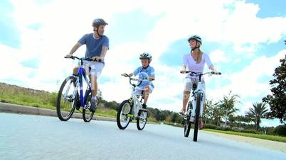 Young Caucasian Family Cycling Together