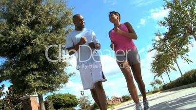 Healthy Ethnic Couple Jogging Exercise