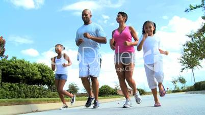 Healthy Young Ethnic Family Jogging Together