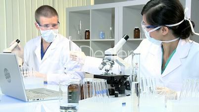 Medical Technicians Studying Research Data