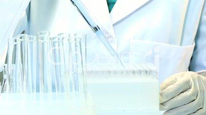 Medical Student Using Laboratory Equipment