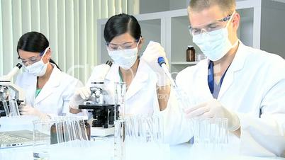 Three Students in Medical Research Laboratory