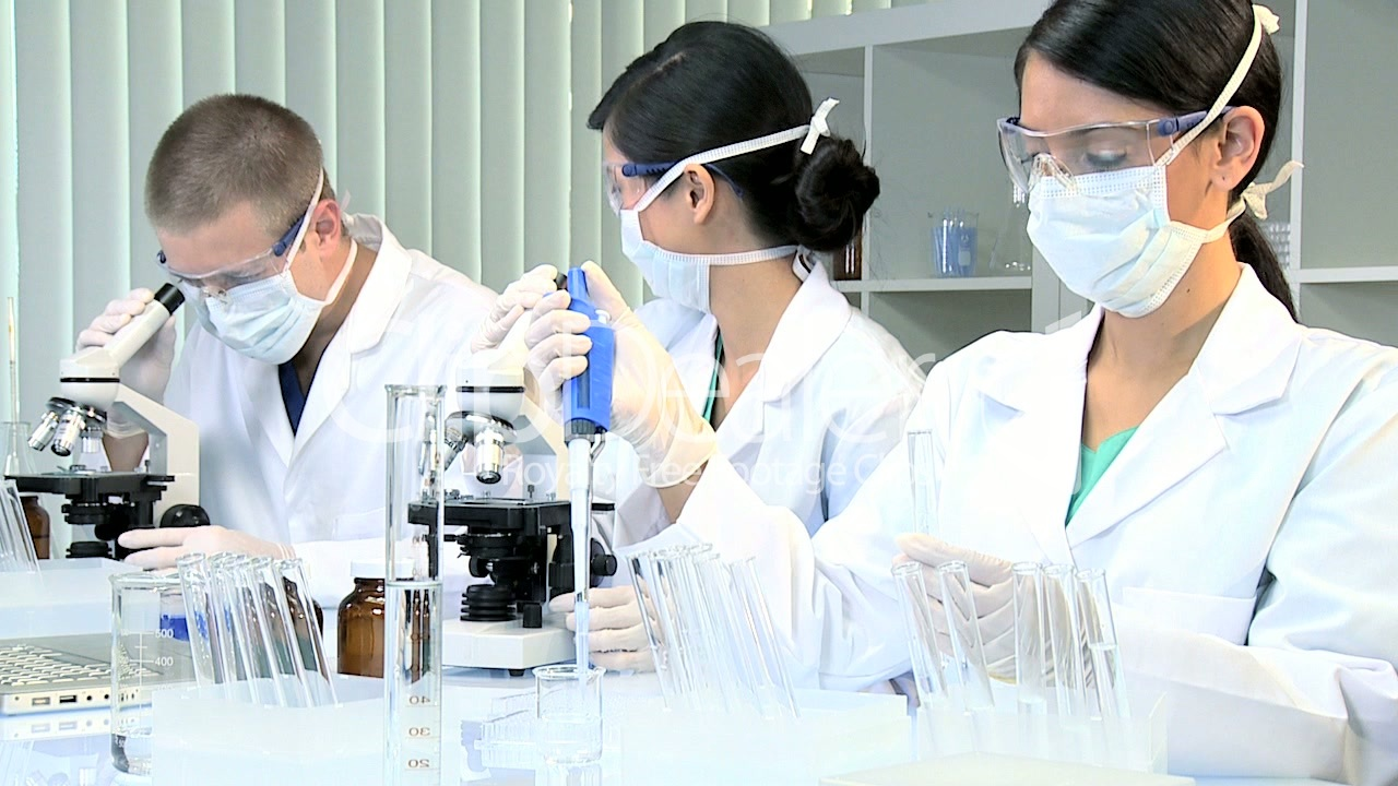 three student doctors studying in hospital laboratory