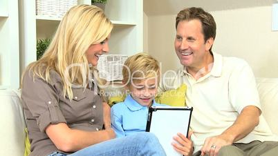 Family Using Online Web Chat Talking to Friends