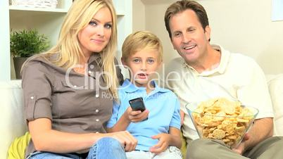 Caucasian Family Watching Movies with Snack Food