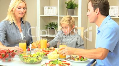 Young Family Sharing Healthy Lunch Together