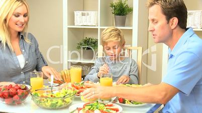 Young Family Enjoying a Healthy Meal
