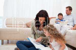 Mother showing photo album to daughter