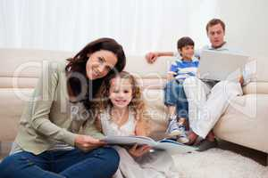 Family spending leisure time in the living room