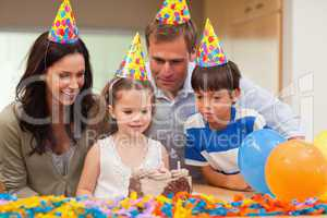Girl blew out the candles on her birthday cake