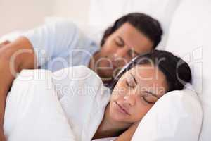 Side view of couple being asleep