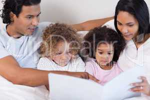 Parents reading a story for their children