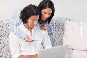 Couple booking vacations online together