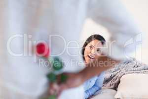 Woman about to get a rose from her boyfriend