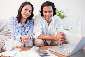 Couple doing online banking in the living room
