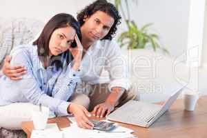 Couple having a hard time paying their bills