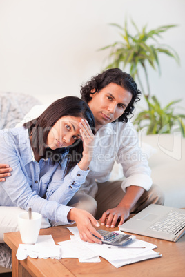 Depressed couple checking their bills