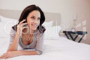 Woman on the bed having a phone call