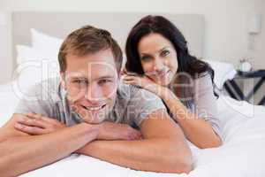 Couple relaxing on the bed together