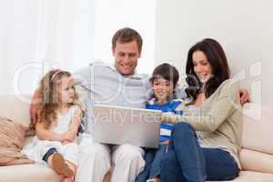 Family surfing the internet together