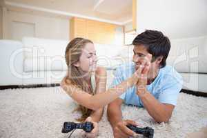 Playful young couple playing video games