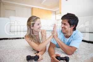 Playful cute couple playing video games