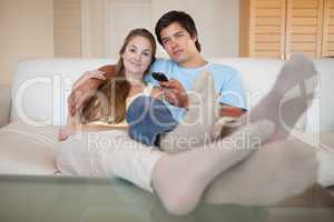 Relaxed couple watching television