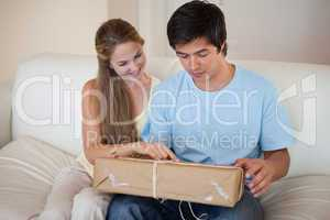 Couple looking at a package