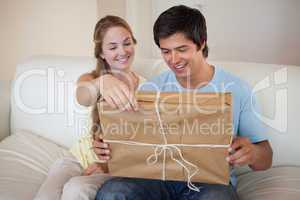 Couple opening a package