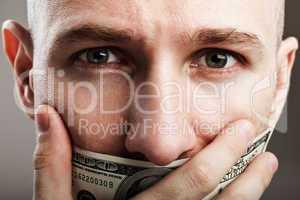 Dollar money gag shut voiceless man