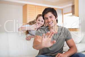 Couple waving at the camera