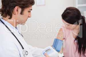 Female having her blood pressure checked