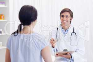 Physician having good news for patient
